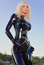 Cat Suit - Susan Wayland is wearing a little black cat suit and you can just see her figure but man is it a amazing one.